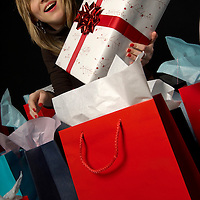Young woman surrounded by shopping bags and presents<br />