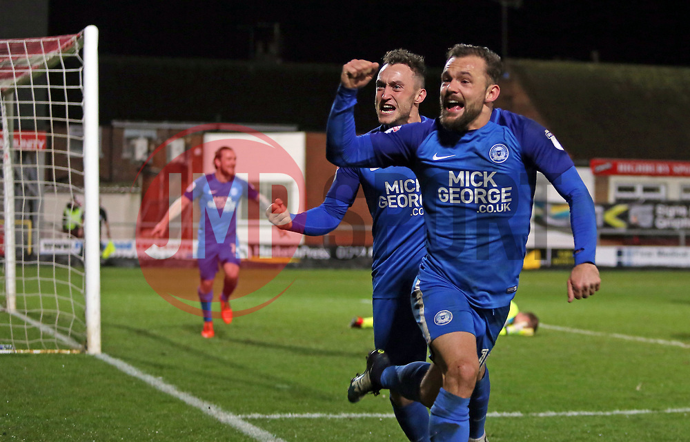 Danny Lloyd of Peterborough United (right) celebrates scoring the winning goal with team-mate Ricky Miller (centre) - Mandatory by-line: Joe Dent/JMP - 17/12/2017 - FOOTBALL - Highbury Stadium - Fleetwood, England - Fleetwood Town v Peterborough United - Sky Bet League One