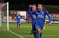 Danny Lloyd of Peterborough United (right) celebrates scoring the winning goal with team-mate Ricky Miller (centre) - Mandatory by-line: Joe Dent/JMP - 17/12/2017 - FOOTBALL - Highbury Stadium - Fleetwood, England - Fleetwood Town v Peterborough United - Sky Bet League One