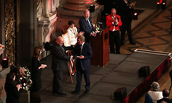 Kenny Dalglish (centre) receives his medal after being awarded Freedom of the City of Liverpool at a ceremony in Liverpool Town Hall.