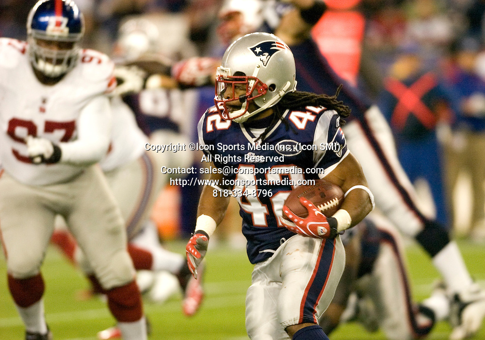 6 November 2011.  Patriot Running Back BenJarvus Green-Ellis (42) with a third quarter run.  The New York Giants beat the New England Patriots 24 to 20 in Gillette Stadium in Foxboro on a Sunday afternoon game.