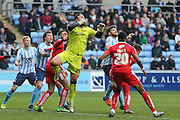 Swindon Town goalkeeper Tyrell Belford (25)  waits for the corner to arrive during the Sky Bet League 1 match between Coventry City and Swindon Town at the Ricoh Arena, Coventry, England on 19 March 2016. Photo by Simon Davies.