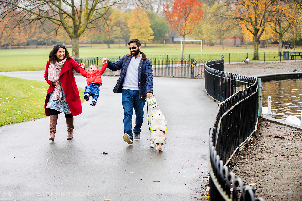 Guide Dog owner Amit and family with their dog Kika. <br /> Picture date: Wednesday November 15, 2017.<br /> Photograph by Christopher Ison for Guide Dogs &copy;<br /> 07544044177<br /> chris@christopherison.com<br /> www.christopherison.com