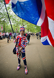 © London News Pictures. 05/06/2012. London, UK.  A man dressed head to toe in the union flag waving a union flag on The Mall during Diamond Jubilee celebrations on June 5, 2012.  Photo credit: Ben Cawthra/LNP