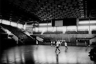 "Young men play soccer/football in the national sports hall, built by the Chinese government, according to a US Embassy communique leaked by Wikileaks that claims, ""China has...provided the Surinamese a series of highly visible projects.  The Chinese built the national sports hall, completed several years ago, was the only place large enough to accommodate the People's United Assembly when it gathered to elect a President last August (2005)""."