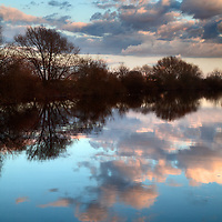 Winter Trees and Clouds Reflected in the River Aire Ferrybridge West Yorkshire England