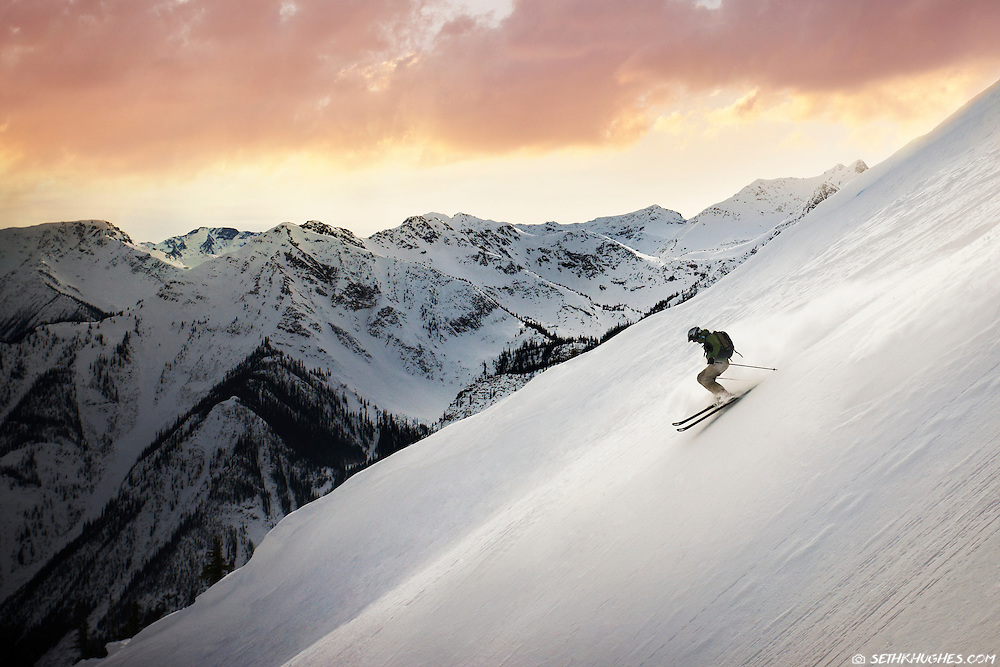 Skiing fresh powder at Kicking Horse ski resort in British Columbia, Canada.