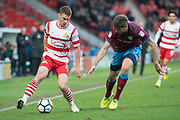 Doncaster Rovers Midfielder Tommy Rowe (10) on the attack (left) Scunthorpe United defender Cameron Burgess (21) (right) gives chase during the The FA Cup match between Doncaster Rovers and Scunthorpe United at the Keepmoat Stadium, Doncaster, England on 3 December 2017. Photo by Craig Zadoroznyj.