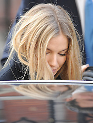 © London News Pictures. 24/11/2011. London, UK.  Actress SIENNA MILLER  leaving at The Royal Courts of Justice today (24/11/2011) after giving evidence at the Leveson Inquiry into press standards. The inquiry is being lead by Lord Justice Leveson and is looking into the culture, and practice of the UK press. Photo credit : Ben Cawthra/LNP