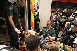 J11 protest.<br /> London Ambulance staff carry a protestor away on a stretcher following the occupation of a house on Beak St, Soho during the J11 protest in central London by the StopG8 anti-capitalist movement,<br /> London, United Kingdom<br /> Tuesday, 11th June 2013<br /> Picture by Mark  Chappell / i-Images