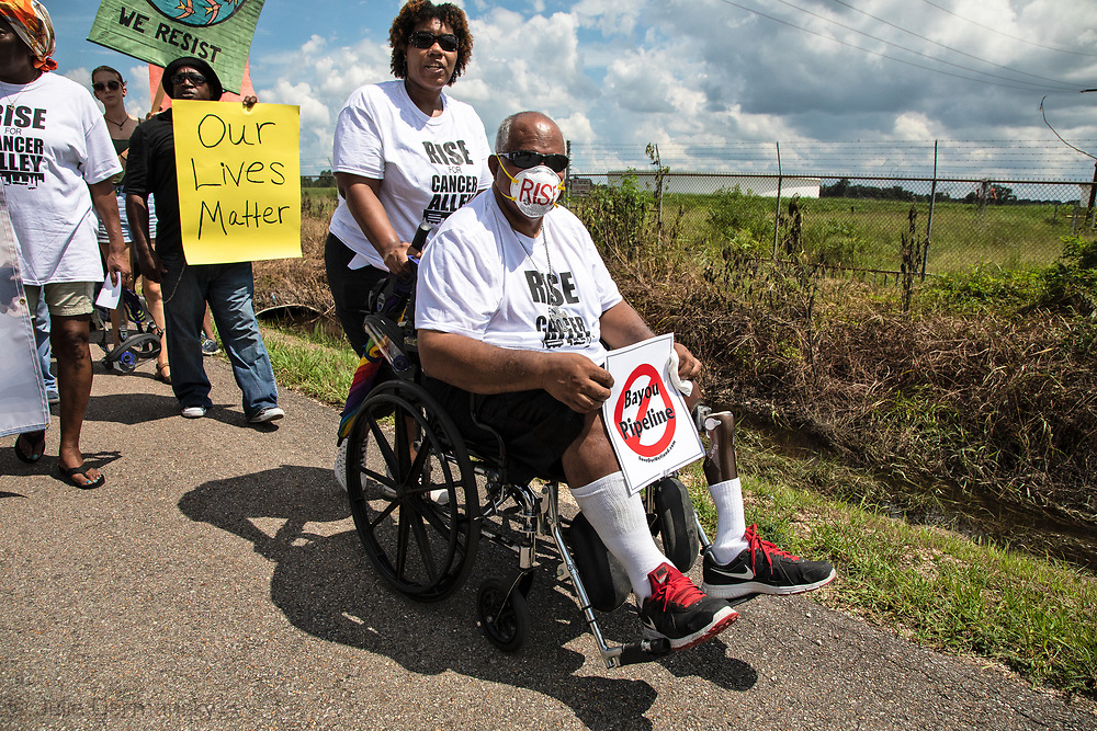 Milton Cayette, Jr. taking part in the Rise for Cancer Alley march in St. James, Louisiana on Burton Lane.