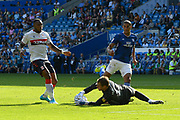 Alex Smithies (12) of Cardiff City makes a save at the feet of Britt Assombalonga (9) of Middlesbrough during the EFL Sky Bet Championship match between Cardiff City and Middlesbrough at the Cardiff City Stadium, Cardiff, Wales on 21 September 2019.