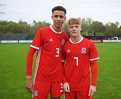 NEWPORT, WALES - Monday, October 14, 2019: Wales' Luca Hoole (L) and Sam Pearson after an Under-19's International Friendly match between Wales and Austria at Dragon Park. Wales won 2-0. (Pic by David Rawcliffe/Propaganda)