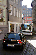 Car reversing in a narrow cobbled street to allow a coach to pass ..., Travel, lifestyle