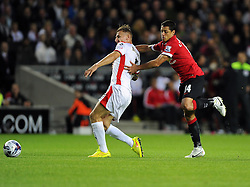 Milton Keynes Dons' Kyle McFadzean is fouled by Manchester United's Javier Hernandez - Photo mandatory by-line: Joe Meredith/JMP - Mobile: 07966 386802 26/08/2014 - SPORT - FOOTBALL - Milton Keynes - Stadium MK - Milton Keynes Dons v Manchester United - Capital One Cup