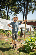 Rex Rolle talks to visitors on a Get Dirty Farm Tour in Portland, Oregon.