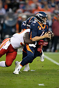 Kansas City Chiefs linebacker Justin Houston (50) sacks Denver Broncos quarterback Case Keenum (4) for a loss of 7 yards to the Broncos 24 yard line in the first quarter during the NFL week 4 regular season football game against the Denver Broncos on Monday, Oct. 1, 2018 in Denver. The Chiefs won the game 27-23. (©Paul Anthony Spinelli)