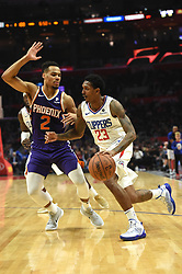 November 28, 2018 - Los Angeles, CA, U.S. - LOS ANGELES, CA - NOVEMBER 28: Los Angeles Clippers Guard Lou Williams (23) drives around Phoenix Suns Guard Elie Okobo (2) during an NBA game between the Phoenix Suns and the Los Angeles Clippers on November 28, 2018, at STAPLES Center in Los Angeles, CA. (Photo by Chris Williams/Icon Sportswire) (Credit Image: © Chris Williams/Icon SMI via ZUMA Press)