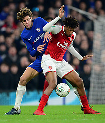 Alex Iwobi of Arsenal battles for the ball with Marcos Alonso of Chelsea - Mandatory by-line: Alex James/JMP - 10/01/2018 - FOOTBALL - Stamford Bridge - London, England - Chelsea v Arsenal - Carabao Cup semi-final first leg