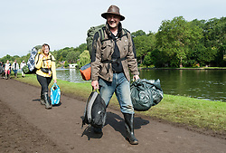 © Licensed to London News Pictures. 30/08/2015. Reading, UK.  Festival goers at Reading Festival 2015, Day 3 Sunday leave the festival for their homeward journey carrying their bags and tents.  Photo credit: Richard Isaac/LNP