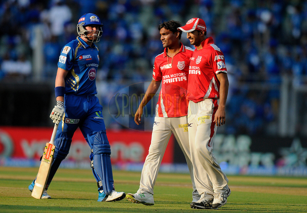 Sandeep Sharma of the Kings X1 Punjab celebrates the wicket of Ben Dunk of the Mumbai Indians as the latter walks past during match 22 of the Pepsi Indian Premier League Season 2014 between the Mumbai Indians and the Kings XI Punjab held at the Wankhede Cricket Stadium, Mumbai, India on the 3rd May  2014<br /> <br /> Photo by Pal Pillai / IPL / SPORTZPICS<br /> <br /> <br /> <br /> Image use subject to terms and conditions which can be found here:  http://sportzpics.photoshelter.com/gallery/Pepsi-IPL-Image-terms-and-conditions/G00004VW1IVJ.gB0/C0000TScjhBM6ikg