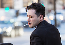 Julian Manea, 36, winks at the camera outside Westminster Magistrates Court in London where he faces allegations of stalking Veronica Bisquert and sharing 'revenge porn'. Westminster Magistrates Court, London, February 15 2018.