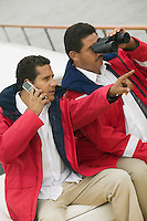 Men on Boat with Cell Phone and Binoculars
