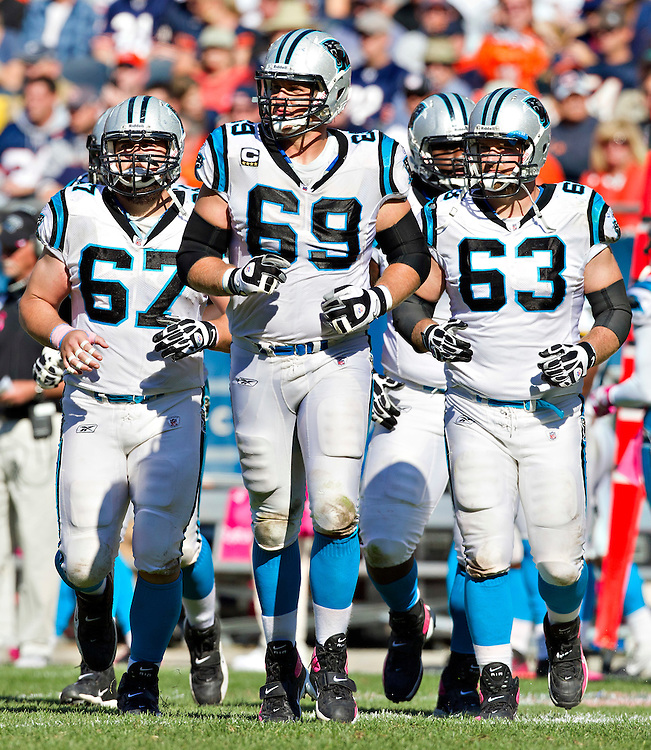 CHICAGO, IL - OCTOBER 2:   Jordan Gross #69, Ryan Kalil #67 and Geoff Hangartner #63 of the Carolina Panthers jog onto the field during a game against the Chicago Bears at Soldier Field on October 2, 2011 in Chicago, Illinois.  The Bears defeated the Panthers 34 to 29.  (Photo by Wesley Hitt/Getty Images) *** Local Caption *** Jordan Gross; Ryan Kalil; Geoff Hangartner