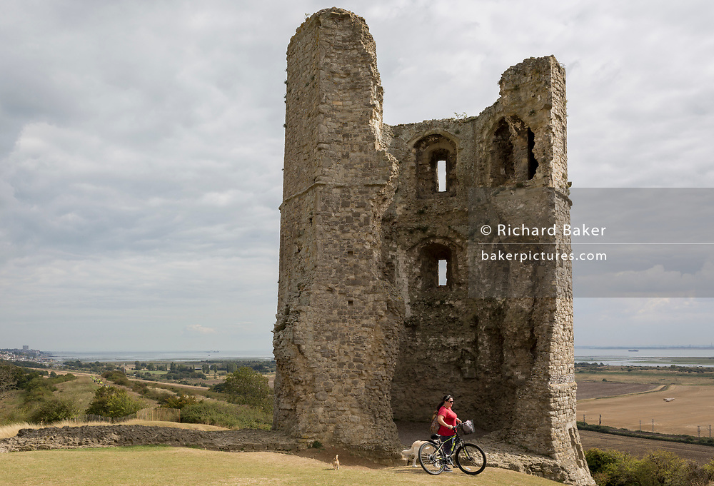 The remains of Hadleigh Castle on 10th September 2019, in Hadleigh, Essex, England. Hadleigh Castle is a ruined fortification in the English county of Essex, overlooking the Thames Estuary from south of the town of Hadleigh. Built after 1215 during the reign of Henry III by Hubert de Burgh, the castle was surrounded by parkland and had an important economic and defensive role. The castle was significantly expanded and remodelled by Edward III, who turned it into a grander property,