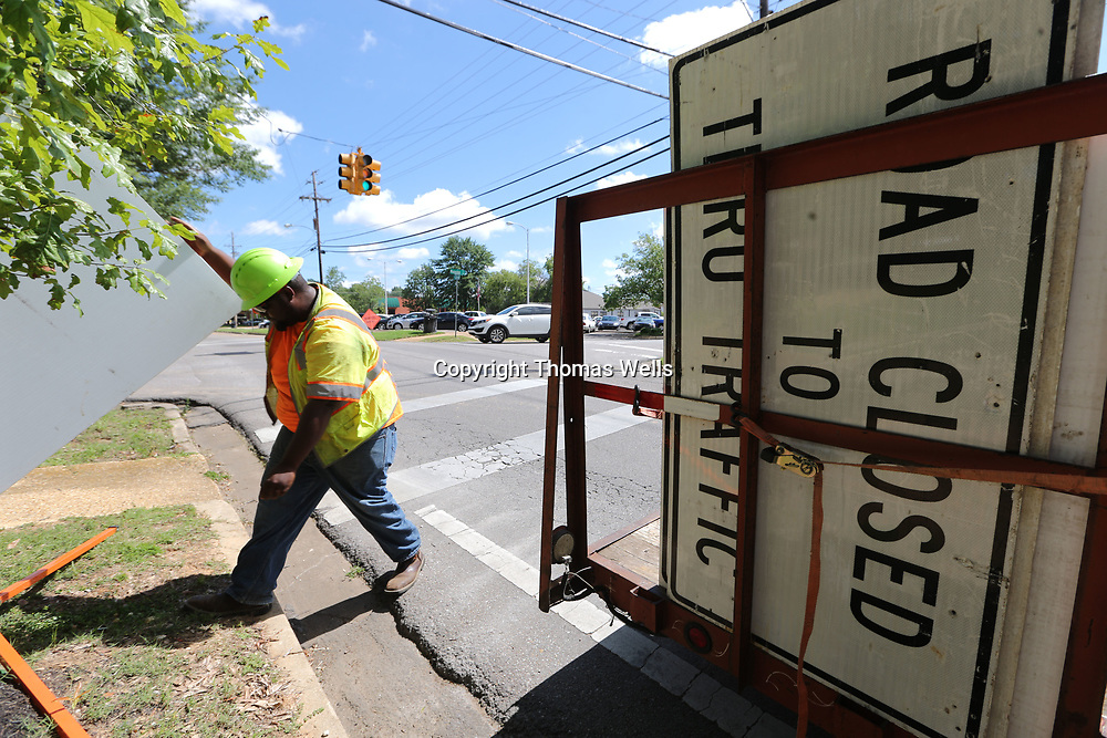 Tony Gonzales begins unloading detour and road closed signs along South Green Street and other streets around downtown Tupelo as work along the BNSF railroad is causing road closures