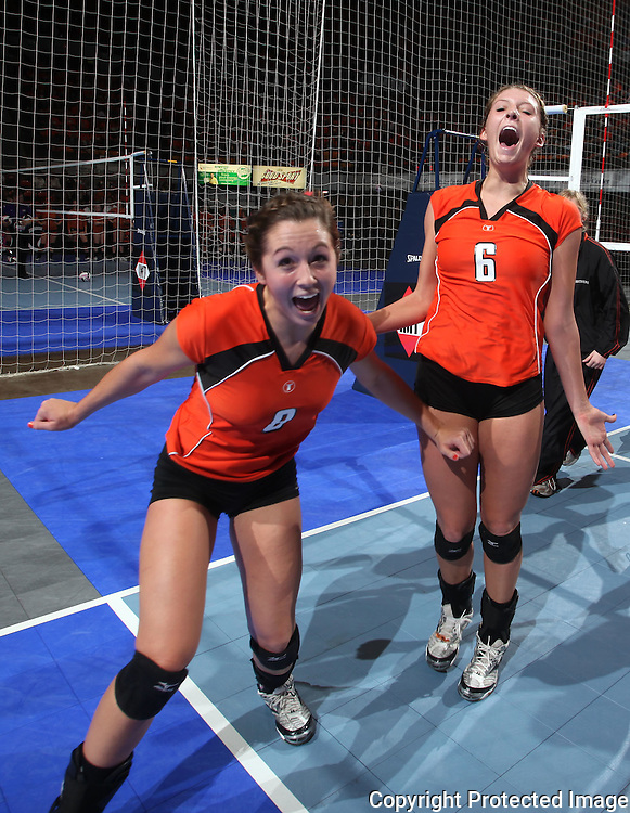 Tripoli's Ashlen Damm (8) and Megan Gilbert (6) after their 1A semifinal match in the state volleyball tournament at the U.S. Cellular Center at 370 1st Ave E on Friday evening, November 12, 2010. (Stephen Mally/Freelance)