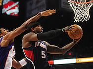 Feb. 23, 2011; Phoenix, AZ, USA; Atlanta Hawks forward Josh Smith (5) puts up a shot against the Phoenix Suns forward Channing Frye (8) at the US Airways Center. Mandatory Credit: Jennifer Stewart-US PRESSWIRE