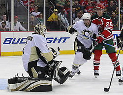 Mar 17, 2010; Newark, NJ, USA; Pittsburgh Penguins goalie Brent Johnson (1) makes a glove save while New Jersey Devils left wing Patrik Elias (26) looks for the rebound during the second period at the Prudential Center.