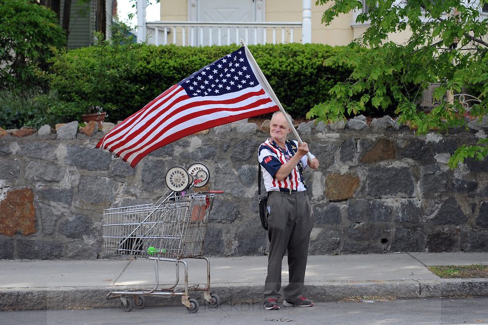 Despite no formal event or parade, Harry Rogers was up early to celebrate Memorial Day on the street in Roslindale, May 25, 2015.