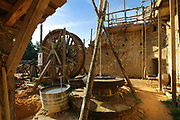 Lifting gear or squirrel cage with single drum in the courtyard of the Chateau de Guedelon, a castle built since 1997 using only medieval materials and processes, photographed in 2017, in Treigny, Yonne, Burgundy, France. The Guedelon project was begun in 1997 by Michel Guyot, owner of the nearby Chateau de Saint-Fargeau, with architect Jacques Moulin. It is an educational and scientific project with the aim of understanding medieval building techniques and the chateau should be completed in the 2020s. Picture by Manuel Cohen