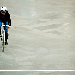 London, UK - 17 January 2013: a visitor tests a bicycle during the London Bike show 2013 at Excel.