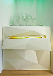 Esque Glass Sculpture topped on dresser in foyer with golf leaf lined drawer. Interior designed by Andee Hess of Osmose.