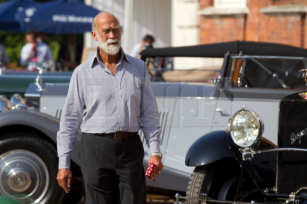 © Licensed to London News Pictures. 05/09/2013. London, UK. Prince Michael of Kent is seen looking at classic automobiles at the St James's Concours of Elegance classic car event at Royal Gardens of St James's Palace in London today (05/09/2013). The event, which alternates each year between Windsor Castle and St James's Palace, features sixty rare cars from across the world and takes place over the next three days. Photo credit: Matt Cetti-Roberts/LNP