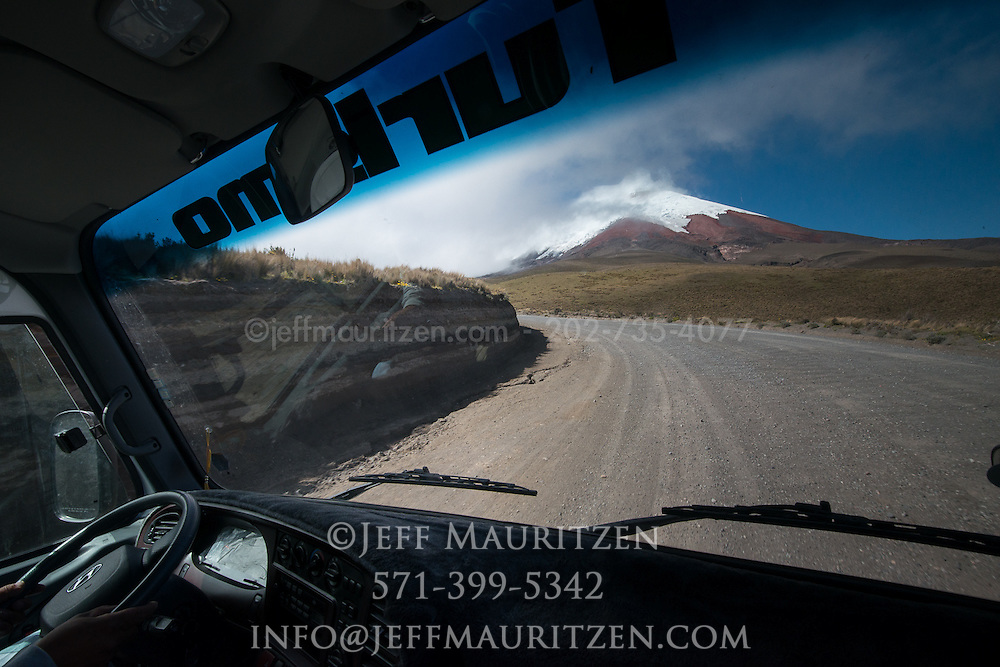 A bus drives up the road that leads up the slopes of Cotopaxi volcano in Ecuador.