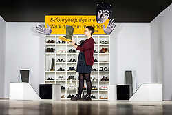 © Licensed to London News Pictures. 28/03/2018. Wakefield, UK. Kerry Chase looks at the In My Shoes sculpture by Bedwyr Williams that forms part of the new In My Shoes exhibition which explores the ways in which UK based artists have represented themselves in their work since the 1990's, the exhibition features early work by Tracey Emin, Sarah Lucas, Gavin Turk & Bebwyr Williams. Photo credit: Andrew McCaren/LNP