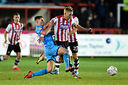 Dean Moxey (21) of Exeter City on the attack challenged by Gavin Reilly (20) of Cheltenham Town during the EFL Sky Bet League 2 match between Exeter City and Cheltenham Town at St James' Park, Exeter, England on 16 November 2019.