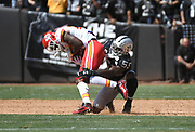 Sep 15, 2019; Oakland, CA, USA; Oakland Raiders outside linebacker Vontaze Burfict (55) tackles Kansas City Chiefs running back LeSean McCoy (25) at Oakland-Alameda County Coliseum. The Chiefs defeated the Raiders 28-10..(Gerome Wright/Image of Sport)