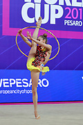 Salos Anastasiia during qualifying at hoop in Pesaro World Cup at Adriatic Arena on April 13, 2018. Anastasiia born on February 18 ,2002 in Barnaul. She is a rhythmic gymnast member of the Belarusian National Team.
