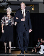 Community role models Susie (left) and and Paul Weaver on the runway during the 23rd Annual Bravo! Fashion Show at the Sinclair Conference Center in downtown Dayton, Friday, October 1, 2010.