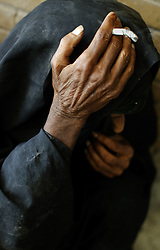 """Fakira Bader, 100, is seen at a retirement home in Sadr City, Baghdad, Iraq, July 22, 2003. Residents like Bader who have bouts of senility live a lonely life, they are left unattended as they wait to die. """"I don't know where I am from,"""" said Bader. """"I have been here all my life.""""  Even though most families in Iraq care for their aging relatives at home, there is still a need for the facility, which is the largest of its kind in Baghdad housing 45 women and 87 men. The facility was not looted during the war, but it is still lacks some funding and is in need of medications for patients with chronic conditions such as heart disease and diabetes."""