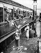 Local residents supplying refreshments to trainload of British soldiers who had been withdrawn from the beaches of Dunkirk on 3-4 June 1940 and brought back to England.  Although there were many losses 335,000 Allied troops were evacuated in the retreat.