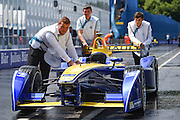 The scrutineers push the Renault E.Dams car back to the garage during Round 9 of Formula E, Battersea Park, London, United Kingdom on 2 July 2016. Photo by Martin Cole.