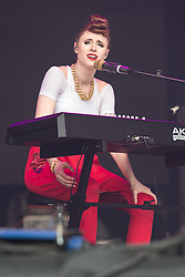 © Licensed to London News Pictures . 07/06/2014 . Heaton Park , Manchester , UK . KIESZA behind a piano keyboard performs on the main stage . The Parklife music festival in Heaton Park Manchester following heavy overnight rain . Photo credit : Joel Goodman/LNP