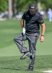 March 30, 2018 - Humble, TX, U.S. - HUMBLE, TX - MARCH 30:  Phil Mickelson (USA) cleans his cleats after hitting from the trap on 1 during Round 2 of the Houston Open on March 30, 2018 at Golf Club of Houston in Humble, Texas.  (Photo by Leslie Plaza Johnson/Icon Sportswire) (Credit Image: © Leslie Plaza Johnson/Icon SMI via ZUMA Press)
