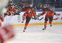 DMITROV, RUSSIA - JANUARY 13: Canada's Audrey-Anne Veillette #7 and Julia Gosling #21 celebrate after a second period goal against Russia during bronze medal game action at the 2018 IIHF Ice Hockey U18 Women's World Championship. (Photo by Steve Kingsman/HHOF-IIHF Images)